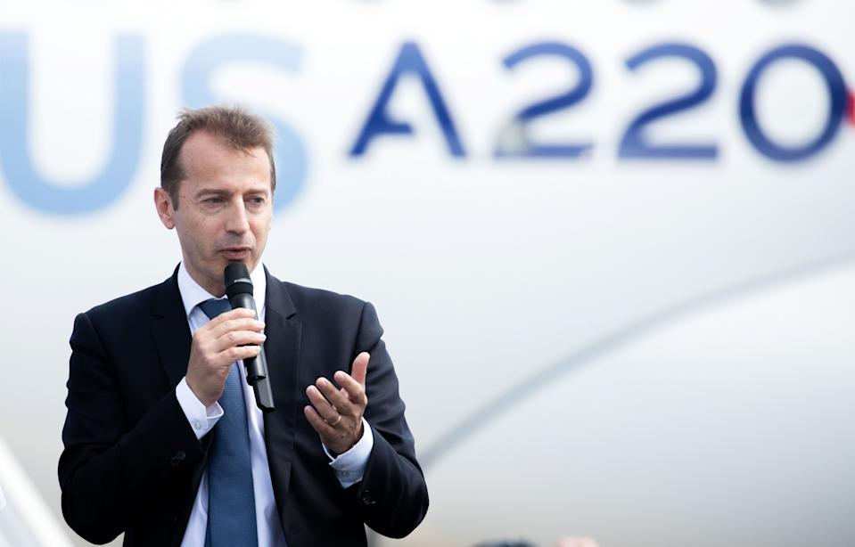 Guillaume Faury, chief executive officer of commercial aircraft at Airbus SE, delivers a speech following the unveiling of the new Airbus A220 single-aisle aircraft in Toulouse, France, on Tuesday, July 10, 2018. Photo: Christophe Morin/Bloomberg