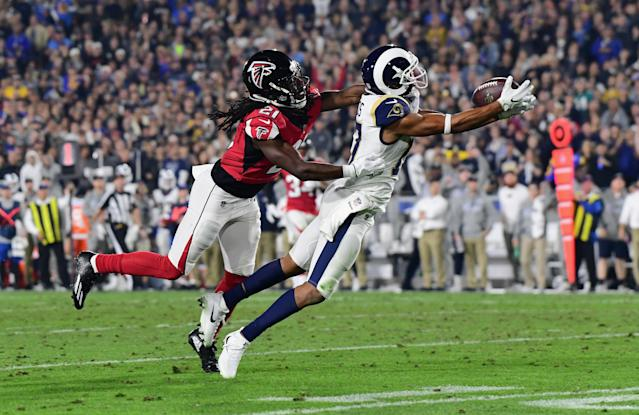 <p>Wide receiver Robert Woods #17 of the Los Angeles Rams makes a catch in front of cornerback Desmond Trufant #21 of the Atlanta Falcons during the second quarter of the NFC Wild Card Playoff game at Los Angeles Coliseum on January 6, 2018 in Los Angeles, California. (Photo by Harry How/Getty Images) </p>