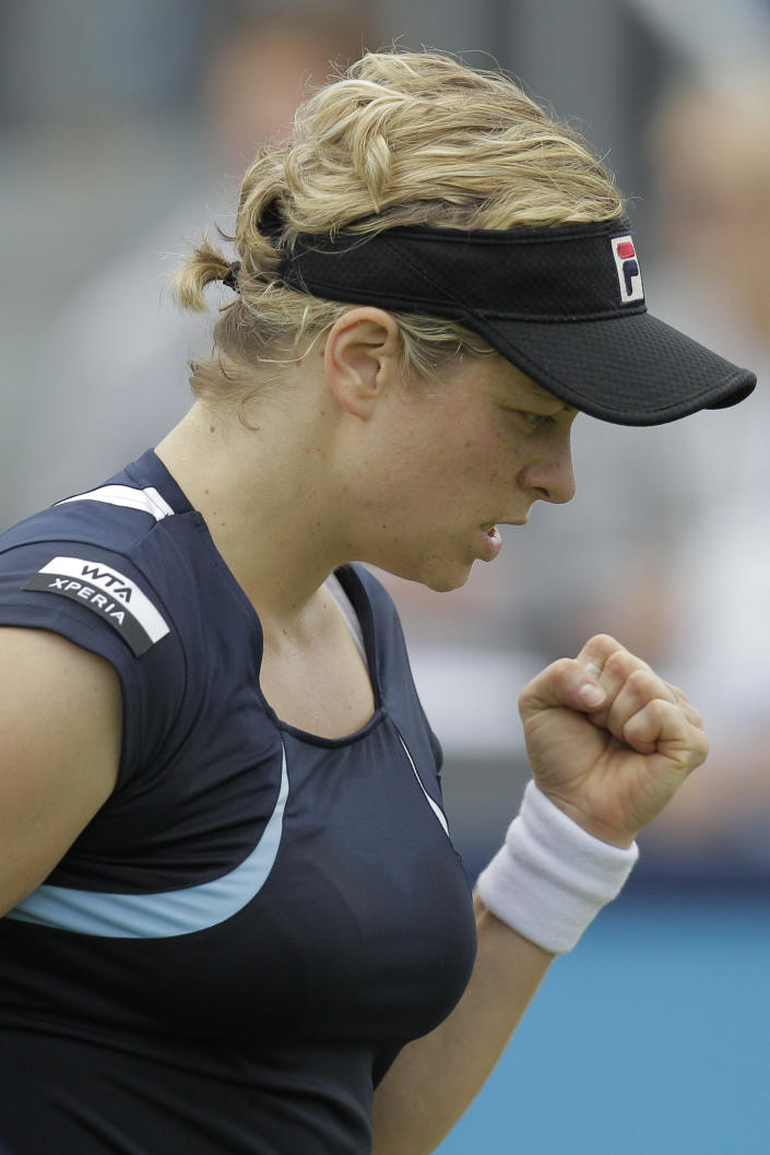 Kim Clijsters of Belgium clneches her fist aftre scoring a point in her match against Francesca Schiavone of Italy at the Unicef Open grass court tennis tournament in Rosmalen, central Netherlands, Thursday, June 21, 2012. Clijsters won in two sets 6-3, 7-6. (AP Photo/Peter Dejong)