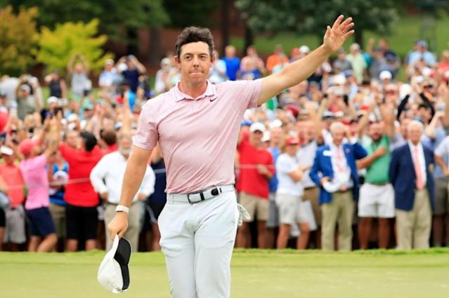 Rory McIlroy celebrates victory at the FedEx Cup (AFP Photo/Cliff Hawkins)