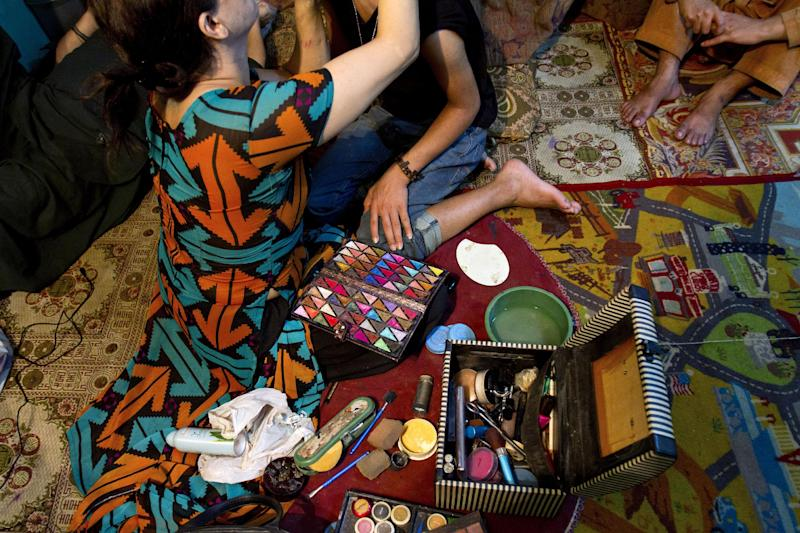 In this Thursday, Oct. 18, 2012, photo, Sumbal 32, left, a Pakistani transgender, applies makeup to her fellow Kate Heart, as they get ready to perform in a wedding, at her apartment in Rawalpindi, Pakistan. Transgender people live in a tenuous position in conservative Pakistan, where the roles of the sexes are traditionally starkly drawn. Families often push them out of the home when they're young, forcing many to prostitute themselves to earn a living. One role where they are tolerated is as dancers at weddings and other celebrations at which men and women are strictly segregated.(AP Photo/Anjum Naveed)