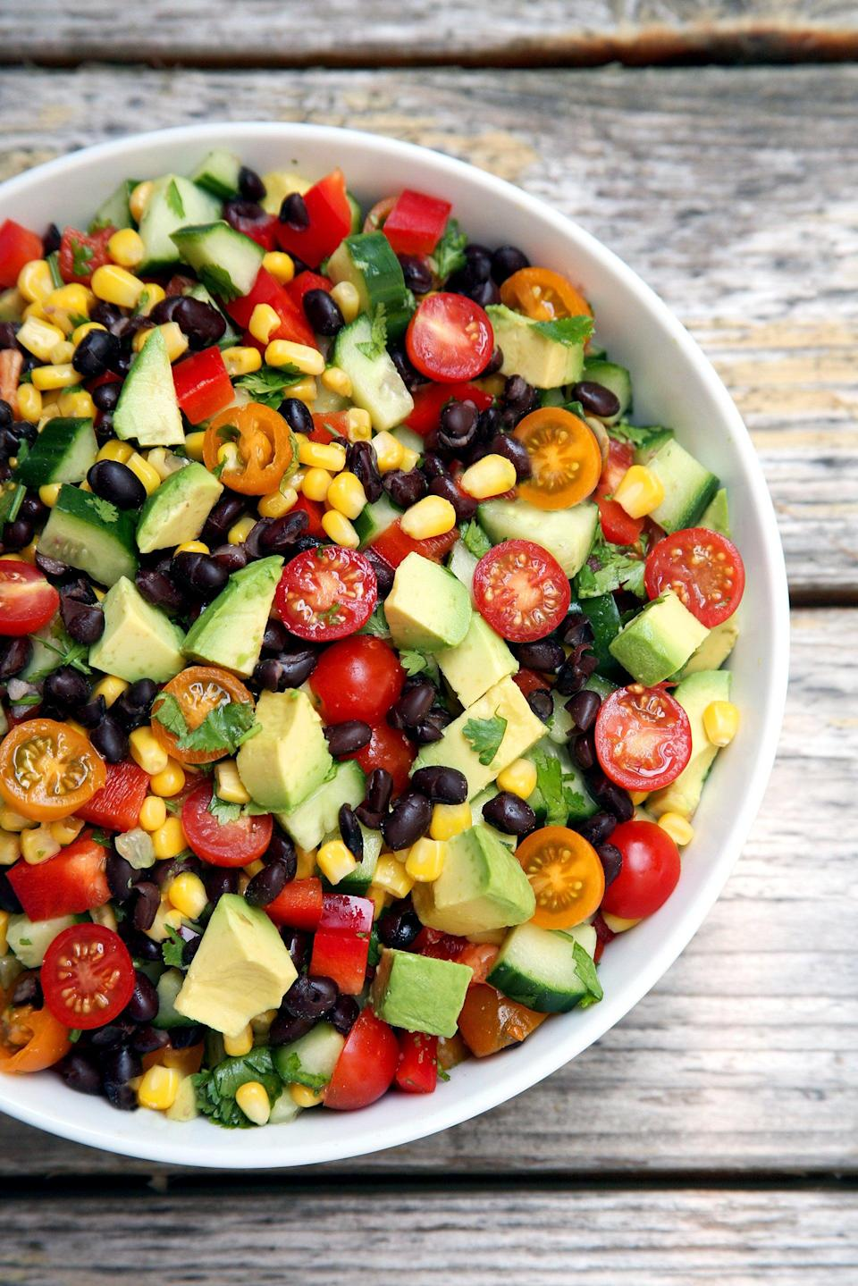 """<p>For a lighter lunch, you could eat this black bean and corn salad as is or eat it with a pita, tortilla chips, or extra protein. It tastes great cold, so we suggest making a big portion and munching on it during the week.</p> <p><strong>Get the recipe:</strong> <a href=""""https://www.popsugar.com/fitness/Cucumber-Black-Bean-Corn-Tomato-Avocado-Salad-37842951"""" class=""""link rapid-noclick-resp"""" rel=""""nofollow noopener"""" target=""""_blank"""" data-ylk=""""slk:cucumber corn salad"""">cucumber corn salad</a></p>"""