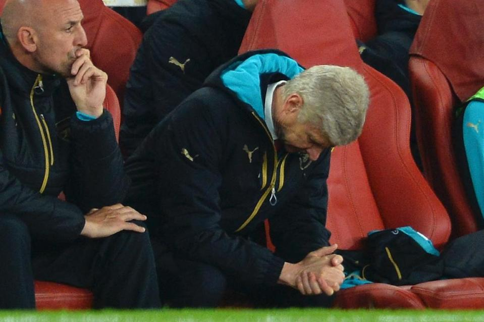 Arsenal manager Arsene Wenger (R) and assistant manager Steve Bould react during their side's Champions League Group F match against Olympiakos at The Emirates Stadium on September 29, 2015 (AFP Photo/Glyn Kirk)