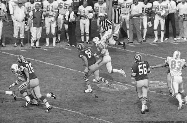 FILE - In this Jan. 15, 1973, file photo, Miami Dolphins' Nick Buoniconti (85) runs after intercepting a pass against the Washington Redskins at the Super Bowl in Los Angeles. The Dolphins won 24-7. Pro Football Hall of Fame middle linebacker Nick Buoniconti, an undersized overachiever who helped lead the Miami Dolphins to the NFL's only perfect season, has died at the age of 78. Bruce Bobbins, a spokesman for the Buoniconti family, said he died Tuesday, July 30, 2019, in Bridgehampton, N.Y. (AP Photo/File)