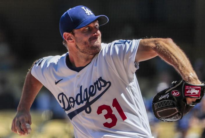 Dodgers starting pitcher Max Scherzer delivers against the San Diego Padres on Sunday.
