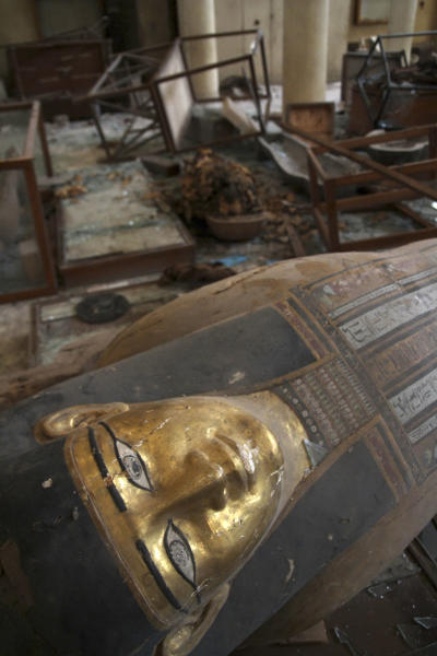 FILE -- In this Saturday, Aug. 17, 2013 file photo, damaged pharaonic objects lie on the floor of the Malawi Antiquities Museum after it was ransacked and looted between the evening of Thursday, Aug. 15 and the morning of Friday, Aug. 16, 2013, in Malawi, south of Minya, Egypt, Saturday, Aug. 17, 2013. The theft of about 1,000 artifacts spanning some 3,500 years of history from a small antiquities museum south of Cairo showcases the tenuous security in the provinces. (AP Photo/Roger Anis, El Shorouk Newspaper, File) EGYPT OUT