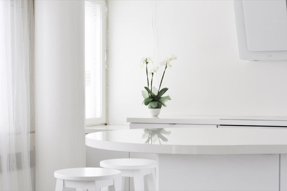 all white kitchen with white table