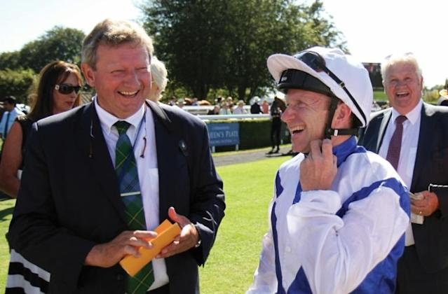 Trainer Mark Johnston, shown with jockey Joe Fanning at Glorious Goodwood in 2018, says Royal Ascot will lack something this year (AFP Photo/Mikaelle Lebreton)