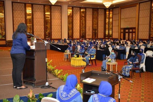 Sugee R Bhanoo, Head of Capabilities APAC, BAE Systems Applied Intelligence providing an overview of the 'Gear up' badge to esteemed members and guests at the Girl Guides Association Malaysia annual conference.