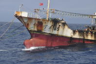 A Chinese-flagged vessel is anchored on the high seas beyond Ecuador's territorial waters near the Galapagos Islands on July 19, 2021. In the summer of 2020, hundreds of Chinese vessels were discovered fishing for squid near the long-isolated Galapagos Islands, a UNESCO world heritage site that inspired 19th-century naturalist Charles Darwin and is home to some of the world's most endangered species, from giant tortoises to hammerhead sharks. (Peter Hammarstedt/Sea Shepherd via AP)