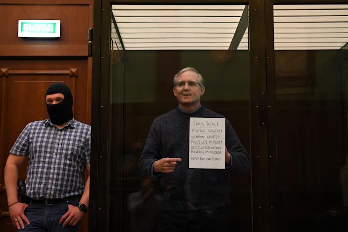 Paul Whelan stands inside a defendants' cage as he waits to hear his verdict in Moscow on June 15, 2020.