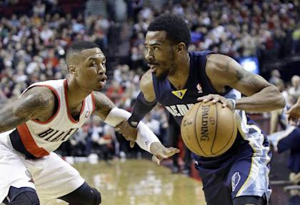 Mike Conley and Damian Lillard could prove to be a great point guard matchup. (AP/Don Ryan)