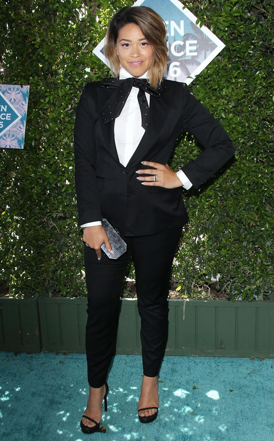 <p>Gina Rodriguez stole the limelight when she rocked up wearing a awesome Cielo suit. <i>[Photo: Rex]</i></p>