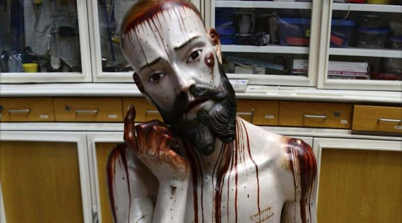 A figure of Jesus Christ known as Lord of Patience and which has human teeth. Photo: Reuters.