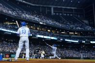 Los Angeles Dodgers' Trea Turner (6) connects for a home run as Dodgers' Max Muncy (13), umpire Chad Whitson, second from left, and Arizona Diamondbacks catcher Carson Kelly look on during the sixth inning of a baseball game Saturday, Sept. 25, 2021, in Phoenix. (AP Photo/Ross D. Franklin)