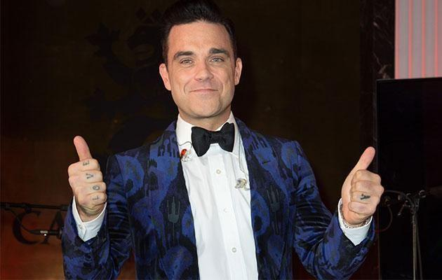 Robbie asked Kyle and Jackie O to cut Kylie Minogue's pubes for him. Photo: Getty Images