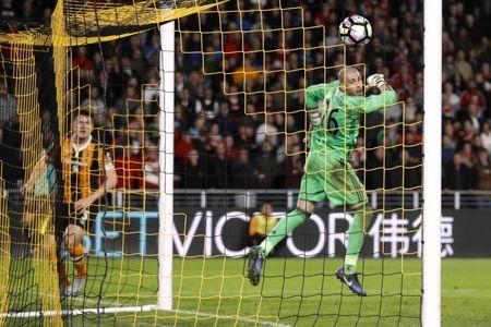 Hull City's Harry Maguire scores their fourth goal as Middlesbrough's Victor Valdes looks on