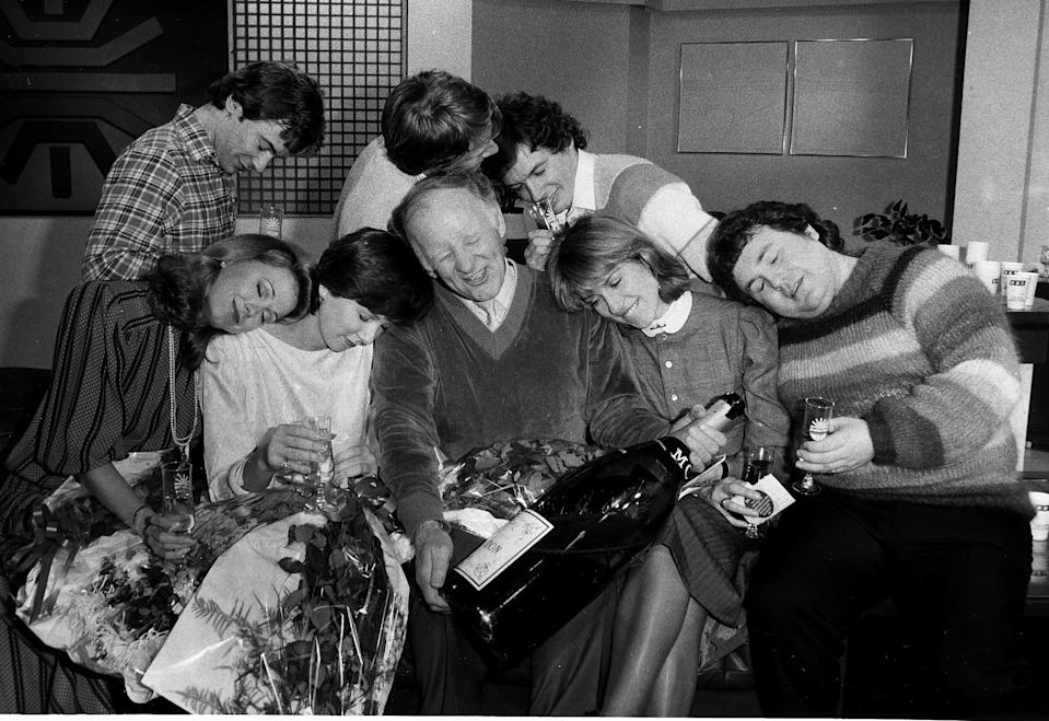 Champagne is poured by staff as BBC Breakfast Television goes on air. Back left to right are: Francis Wilson, Nick Ross, David Icke, Front: Jane Pauley, Debbie Rix, Frank Bough, Selina Scott and Russell Grant January 1983. (Photo by Daily Mirror/Mirrorpix/Getty Images)