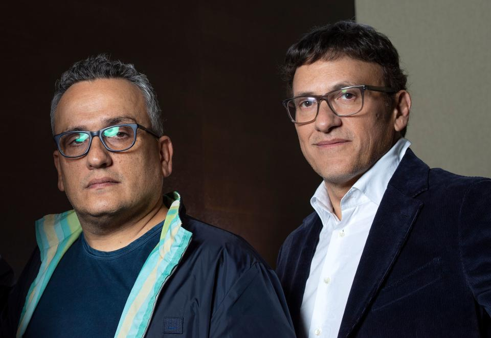 """Directors Joseph Russo (L) and Anthony Russo (R) pose during a photo session for AFP at the 2019 Toronto International Film Festival Day 5 on September 9, 2019, in Toronto, Ontario. - When you have just directed the biggest blockbuster movie of all time, you earn the clout to dictate terms with even the highest executives in Hollywood. But for the Russo brothers, it also raised a question that would be familiar to the superheroes of """"Avengers: Endgame"""" -- what to do next with all that power? (Photo by VALERIE MACON / AFP)        (Photo credit should read VALERIE MACON/AFP via Getty Images)"""