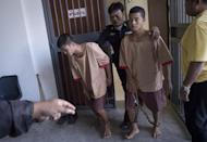 Myanmar nationals Zaw Lin (L) and Win Zaw Tun are planning to appeal the court's verdict (AFP Photo/Nicolas Asfouri )
