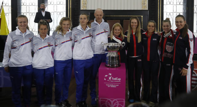 The teams of the Czech Republic, left, and United States, right, pose for a photo in Prague, Czech Republic, Friday, Nov. 9, 2018 after a draw for the tennis Fed Cup Final between Czech Republic and the United States. The final takes place on Saturday, Nov. 10 and Sunday, Nov. 11, 2018. (AP Photo/Petr David Josek)