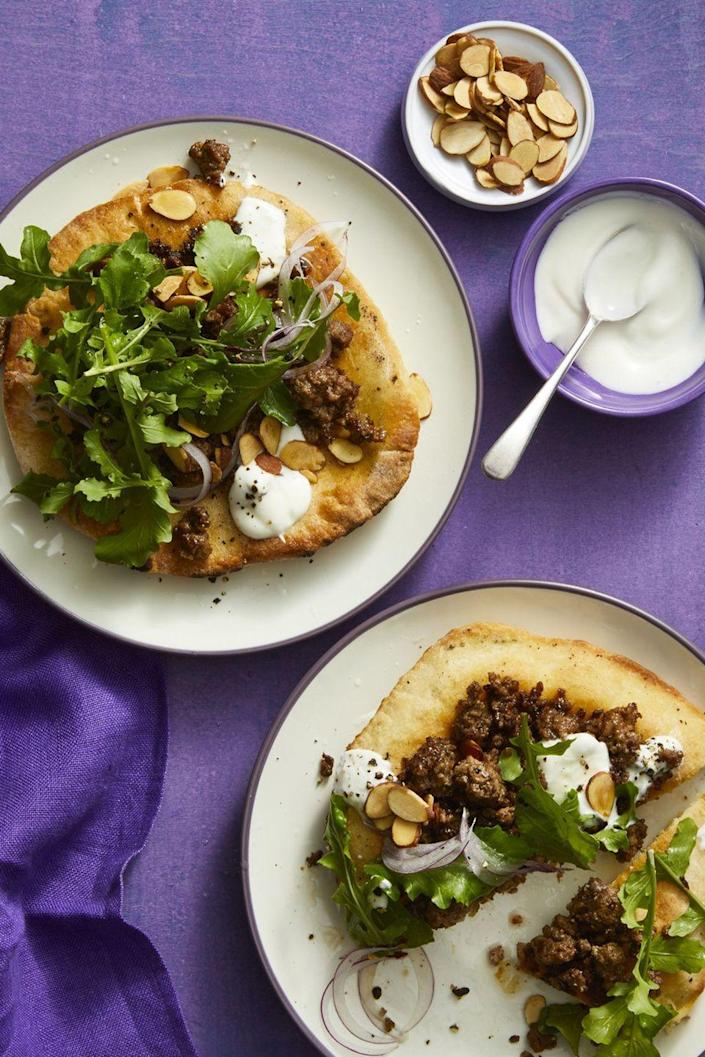 """<p>Turn pizza night into a family affair by making these pita pizzas that come up to less than 400 calories per serving.</p><p><a href=""""https://www.womansday.com/food-recipes/food-drinks/a16765167/mediterranean-pita-pizzas-recipe/"""" rel=""""nofollow noopener"""" target=""""_blank"""" data-ylk=""""slk:Get the Mediterranean Pita Pizzas recipe."""" class=""""link rapid-noclick-resp""""><u><em>Get the Mediterranean Pita Pizzas recipe. </em></u></a></p>"""