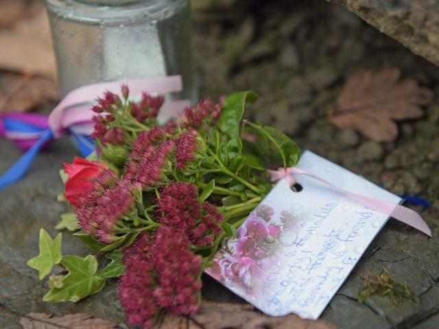 Floral tributes at the scene (Ben Birchall/PA)