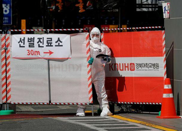 PHOTO: A medical worker in a protective gear closes a gate to the screening center for novel coronavirus at Kyungpook National University Hospital in Daegu, South Korea, March 6, 2020. (Kim Kyung-hoon/Reuters)