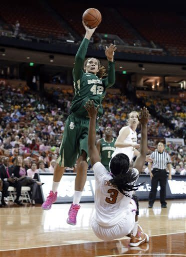 Baylor's Brittney Griner (42) shoots over Texas' Nneka Enemkpali (3) during the first half of an NCAA college basketball game, Saturday, Feb. 9, 2013, in Austin, Texas. (AP Photo/Eric Gay)