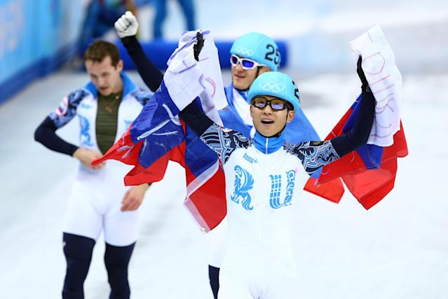 SOCHI, RUSSIA - FEBRUARY 21: Victor An of Russia celebrates winning the gold medal in the Short Track Men's 5000m Relay on day fourteen of the 2014 Sochi Winter Olympics at Iceberg Skating Palace on February 21, 2014 in Sochi, Russia. (Photo by Paul Gilham/Getty Images)