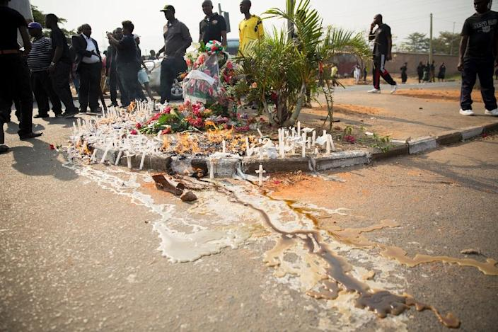 Wax spilt from candles lit during a vigil for Burundian General Adolphe Nshimirimana in Bujumbura, August 9, 2015 (AFP Photo/Griff Tapper)