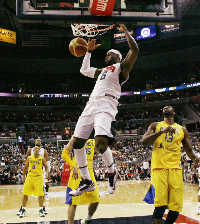 Team USA forward LeBron James (6) dunks the ball with Brazil center Maybyner Rodney Hilario, right, during the first half of an Olympic men's exhibition basketball game, Monday, July 16, 2012, in Washington. (AP Photo/Alex Brandon)