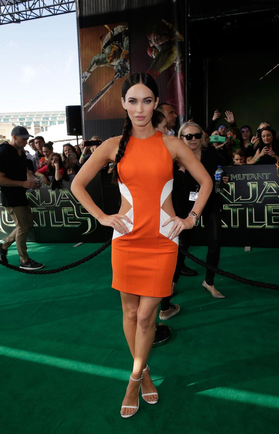 <p>The star wore a cut-out orange dress at the event, teamed with white court shoes and a hair plait. </p>
