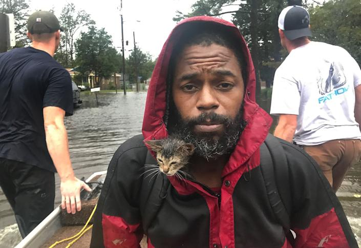 Robert Simmons Jr. and his kitten 'Survivor' are rescued from floodwaters in New Bern, N.C..