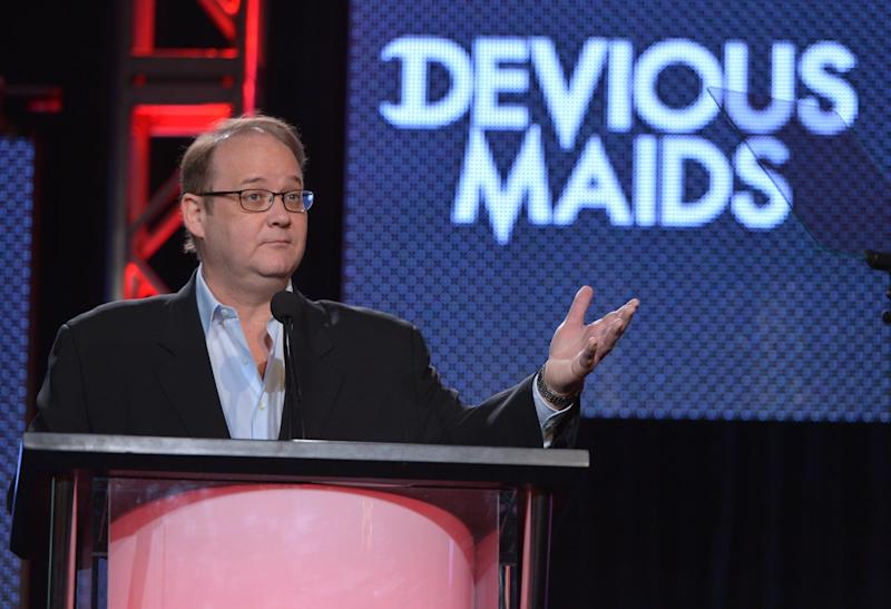 """FILE - In a Thursday, Jan. 9, 2014 file photo, creator and executive producer Marc Cherry speaks on stage at the Lifetime/A&E Winter Press Tour, in Pasadena, Calif. Cherry and Damon Lindelof, creators of two of the most indelible dramas on network television last decade, """"Lost"""" and """"Desperate Housewives,"""" are making programs for cable networks now. Once often content to air reruns, cable networks are busy establishing themselves as creators. (Photo by John Shearer/Invision for A&E Networks/AP Images, File)"""