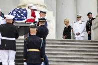 The flag-draped casket of Sen. John McCain, R-Ariz., is carried up the steps of the U.S. Capitol, Friday, Aug. 31, 2018, in Washington as Cindy McCain, top right, joined by her sons Jack McCain, and Jimmy McCain, right, watch. (Jim Lo Scalzo/Pool Photo via AP)