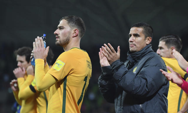 Australia's James Troisi, left and Tim Cahill thanks fans after their World Cup Group B match