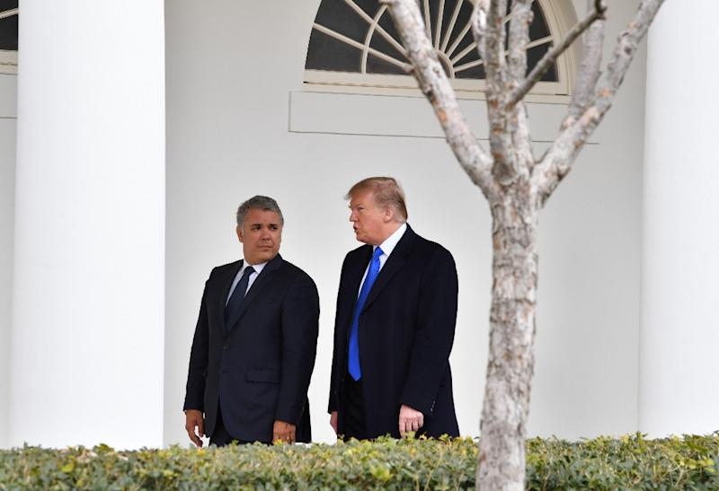 US President Donald Trump (R) greets Colombian President Ivan Duque at the White House on February 13, 2019 (AFP Photo/Nicholas Kamm)
