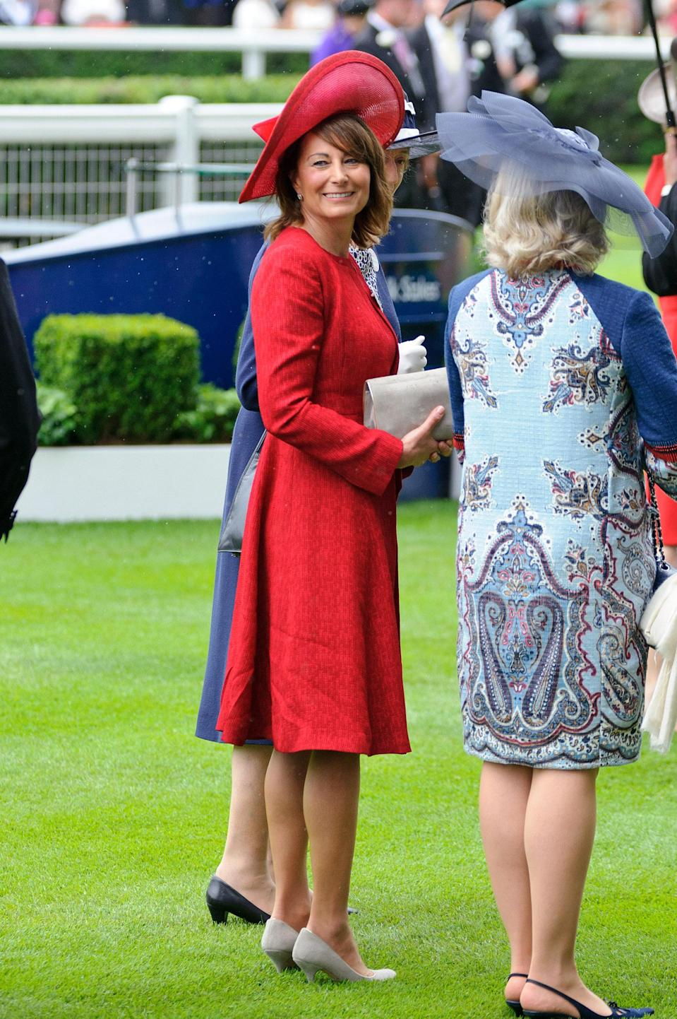 <p>The mother of the Duchess of Cambridge wore a head-to-toe red ensemble with nude accessories for a day at the 2012 races. <em>[Photo: Getty]</em> </p>