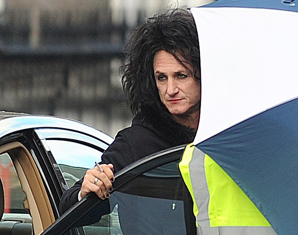 """Hey there sexy! Spotted on the set of his upcoming film, """"This Must Be The Place,"""" Sean Penn, who plays an aging rocker in the flick, got in the spirit with red lipstick, mascara, black nail polish, and a rather dirty mop of hair. <a href=""""http://www.infdaily.com"""" target=""""new"""">INFDaily.com</a> - August 23, 2010"""