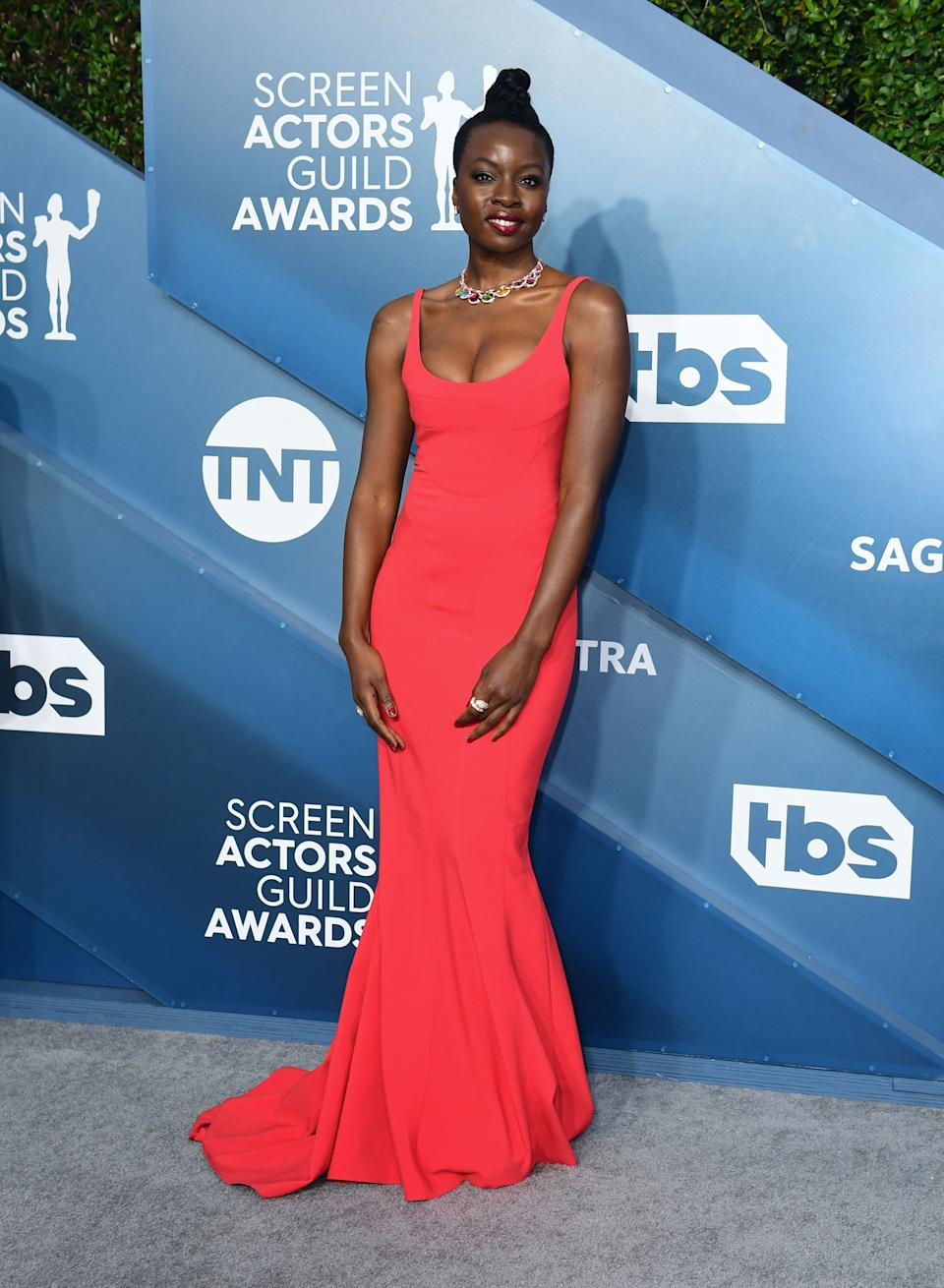"""<h2>Danai Gurira</h2><br>Danai Gurira is looking red hot tonight in this fitted red gown paired with one hell of a technicolor necklace.<br><span class=""""copyright"""">Photo by FREDERIC J. BROWN/AFP via Getty Images.</span>"""