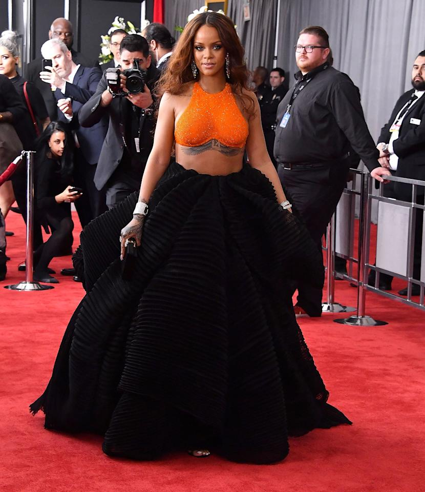 """<p>The look <a href=""""https://www.popsugar.com/fashion/Rihanna-Dress-2017-Grammys-43159487"""" class=""""ga-track"""" data-ga-category=""""Related"""" data-ga-label=""""http://www.popsugar.com/fashion/Rihanna-Dress-2017-Grammys-43159487"""" data-ga-action=""""In-Line Links""""> was an orange Armani Privé crop top</a> complete with a full, ruffled skirt in moody black.</p>"""