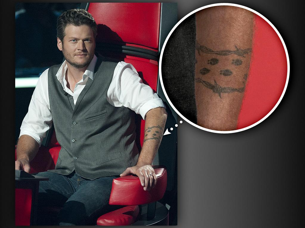 "Blake Shelton<br><br> Blake Shelton has said before, ""I probably have the crappiest tattoo, not only in country music, but maybe in the world."" The tattoo he's referring to is a trail of deer tracks around his left forearm representing his love of hunting. Unfortunately, the deer tracks are constantly mistaken for ladybugs. Annoyed, Blake added a coil of barbed wire to the design, hoping to make it look ""more manly."""
