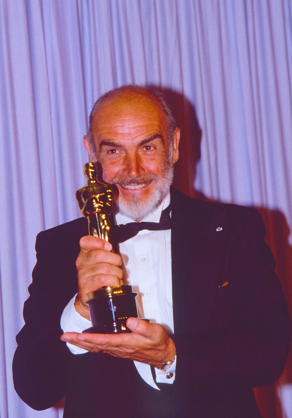 Sean Connery with his Best Supporting Actor Oscar for his role in The Untouchables at the 60th Annual Academy Awards in Los Angeles, 11 Apr 1988 (Photo: Elisa Leonelli/Shutterstock)