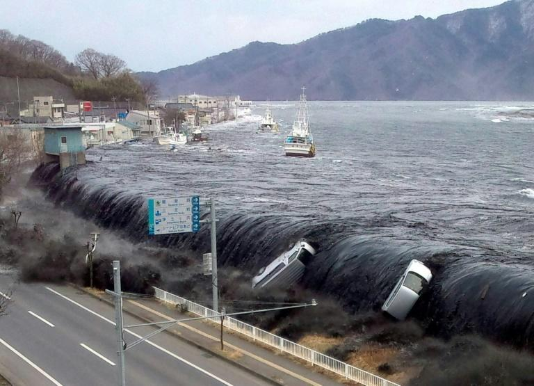 The tsunami breaches an embankment and flows into the city of Miyako in Iwate prefecture