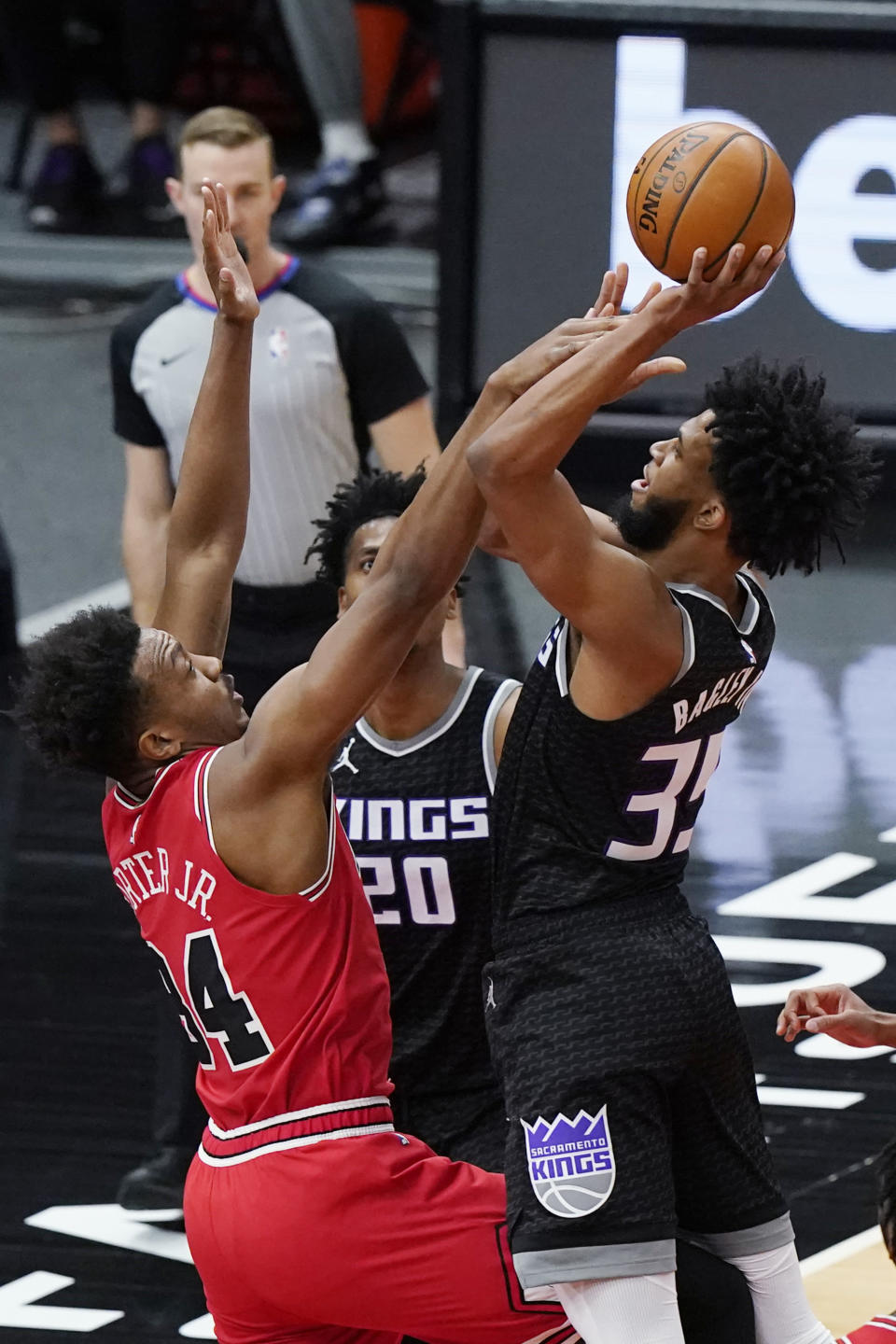 Sacramento Kings forward Marvin Bagley III, right, shoots over Chicago Bulls center Wendell Carter Jr., during the first half of an NBA basketball game in Chicago, Saturday, Feb. 20, 2021. (AP Photo/Nam Y. Huh)