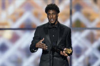 New Orleans Saints' Michael Thomas with his AP Offensive Player of the Year award at the NFL Honors football award show Saturday, Feb. 1, 2020, in Miami. (AP Photo/David J. Phillip)