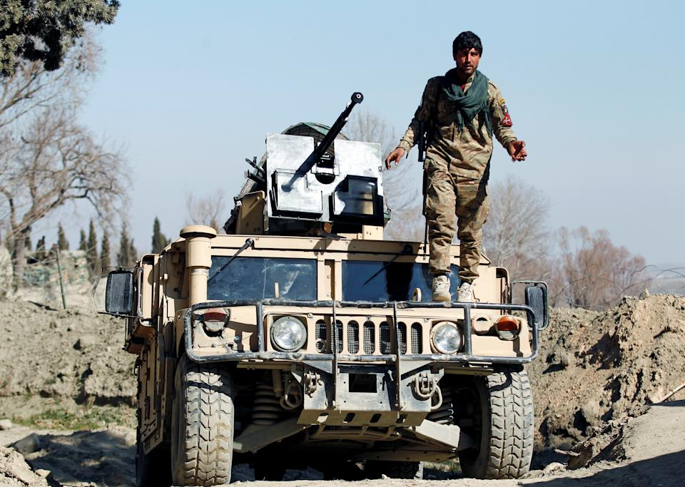 An Afghan security force member stands guard near the site of an incident where two U.S. soldiers were killed earlier in February, in Nangarhar province, Afghanistan. (Reuters/Parwiz)