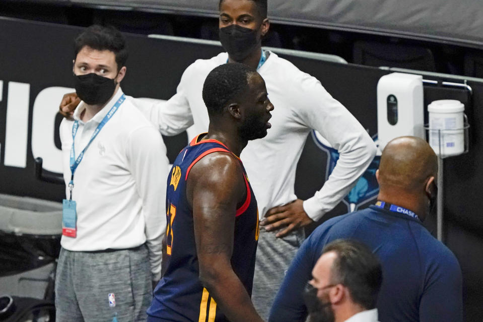 Golden State Warriors forward Draymond Green leaves the court after getting ejected from the game during the second half of an NBA basketball game against the Charlotte Hornets on Saturday, Feb. 20, 2021, in Charlotte, N.C. (AP Photo/Chris Carlson)