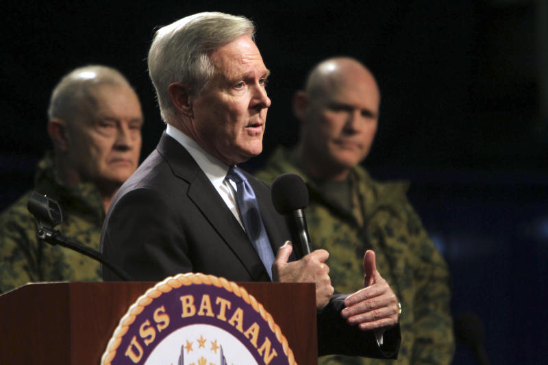 """Navy Secretary Ray Mabus addresses sailors and Marines aboard the LHD Bataan at Norfolk Naval Station in Norfolk, Va., on Monday, March 5, 2012, during an """"all hands"""" call that was televised and streamed live worldwide. Mabus outlined new initiatives in five areas, including responsible use of alcohol and reducing sexual assaults and suicides. Behind him are Marine Lt. General Dennis J. Hejlik, left, and Sergeant Major of the Marine Corps, Micheal P. Barrett. (AP Photo/Virginian-Pilot, Vicki Cronis-Nohe) MAGS OUT"""